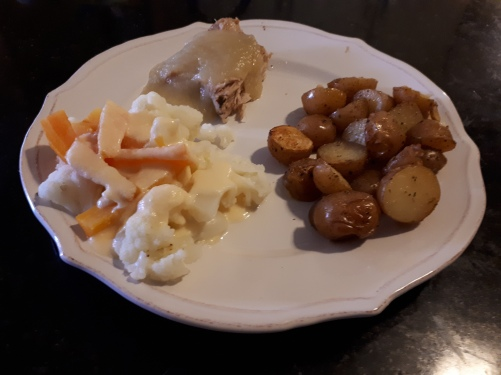 Roated Herb and Garlic Potatoes served with pork roast and applesauce, veggies with cheese sauce